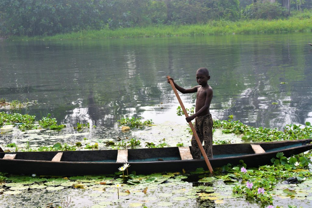 A young boy riding a boat in Ilaje, Ondo state, Nigeria