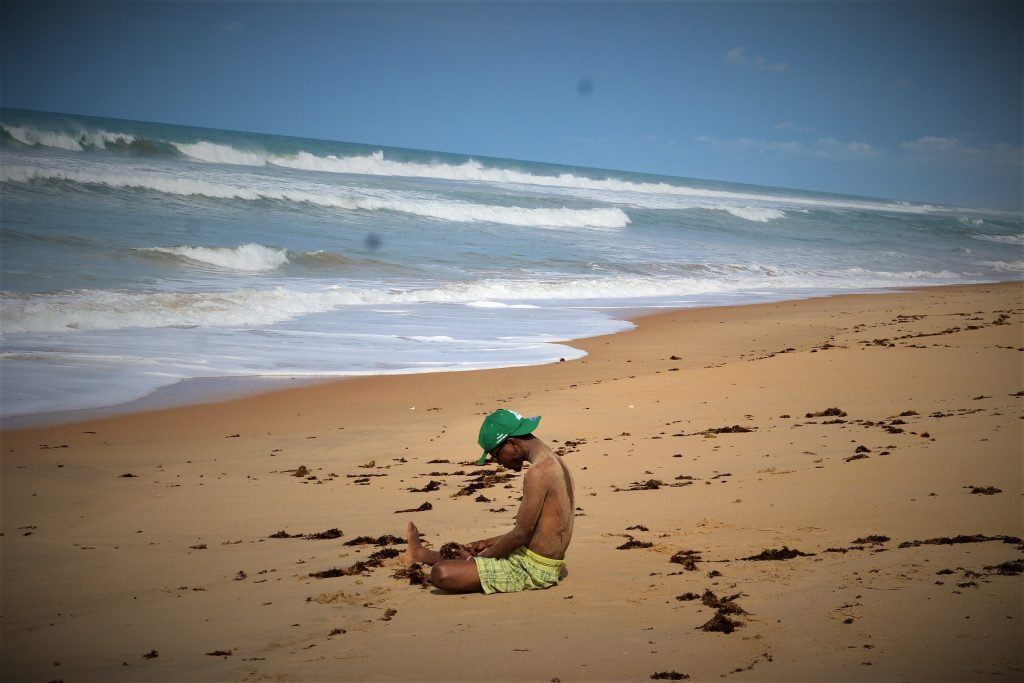 Nigerian Travel Blogger at a beach